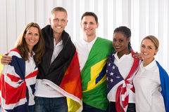 Happy People With Flags From Different Countries Royalty Free Stock Photo