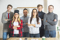 Happy people with folded arms Royalty Free Stock Photography