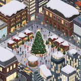 People celebrating Christmas together. Happy people gathering together and celebrating Christmas in the city square around a tree under the snow Stock Image
