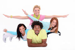 Happy people gesturing fly. Happy young people gesturing fly on the white background Stock Image