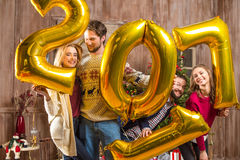 Happy people with golden balloons. Group of happy people with golden 2017 sign balloons Stock Photos