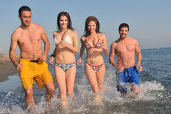 Happy people group have fun and running on beach Royalty Free Stock Image