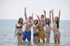 Happy people group have fun and running on beach Royalty Free Stock Photos