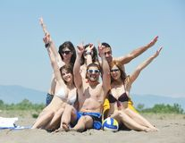 Happy people group have fun and running on beach Royalty Free Stock Images