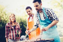 Happy people having camping and having bbq party. Outdoor Stock Photography