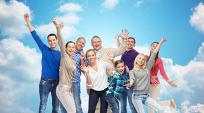 Happy people having fun over sky and clouds Royalty Free Stock Image