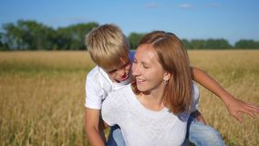 Happy people having fun in wheat field stock video footage