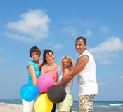 Happy  people holding balloons in CMYK colors Royalty Free Stock Photography