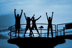 Happy people jump silhouettes Royalty Free Stock Photos