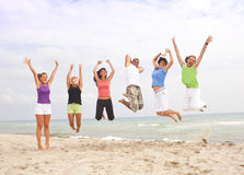 Happy people jumping on the beach Royalty Free Stock Photography