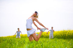 Happy people is jumping in a field Royalty Free Stock Image