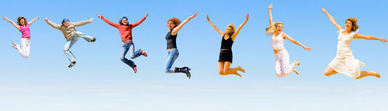 Happy people jumping with joy Stock Photo