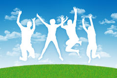 Happy people jumping in joy on a blue sky background Stock Photo