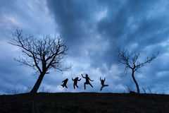 Happy people jumping over the clouds Stock Images