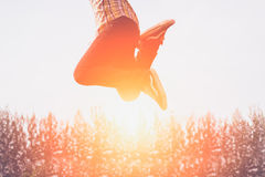 Happy people jumping in sunset. Happy people jumping in sunset Royalty Free Stock Photography