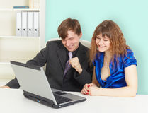 Happy people looking at laptop screen Royalty Free Stock Image