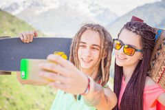 Happy people make selfie on mobile phone at mountain outdoor Royalty Free Stock Photo