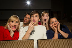 Happy people in movie theatre Stock Photo