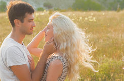 Happy people outdoors beautiful landscape and couple in love wit Royalty Free Stock Images