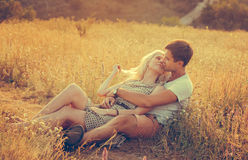 Happy people outdoors beautiful landscape and couple in love wit. Happy people outdoors beautiful landscape and couple in love on sunset near road  vintage stile Stock Images