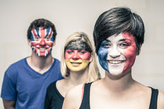 Happy people with painted flags on faces Stock Photo