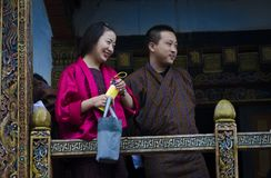 Happy people in traditional dresses. Happy people in Paro, Bhutan in June, 2019 stock image
