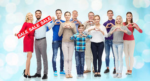 Happy people with percentage sign showing heart Stock Photos