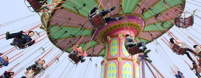 Happy people play chairoplane Royalty Free Stock Images