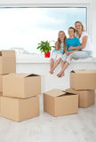 Happy people with a potted plant in their new home Stock Photography