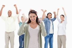 Happy people raising their arms. Focus on the women in foreground Stock Photo