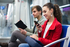 Happy people reading smartphone and e-book Stock Photography