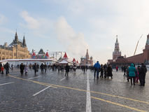 Happy people on Red Square, Moscow. Moscow - November 7, 2016: Happy people and tourists walk on the Red Square during the winter holidays November 7, 2016 Royalty Free Stock Photo