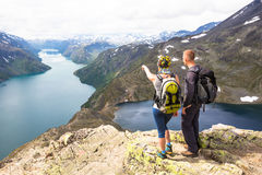 Happy people relax in cliff during trip Norway. Bessegen area Stock Photo