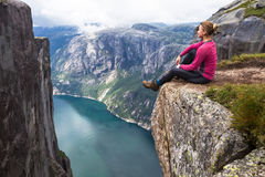 Happy people relax in cliff during trip Norway. hiking route Stock Image