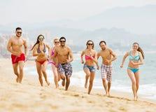 Happy people running at beach Stock Photos