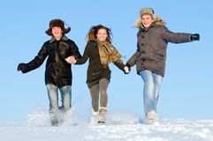 Happy people running in winter Stock Image