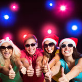 Happy people in Santa hats Royalty Free Stock Image