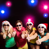 Happy people in Santa hats Stock Image