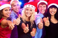 Happy people in Santa hats Stock Photos