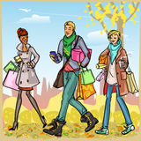 Happy people with shopping bags Stock Image