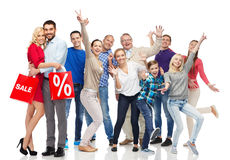 Happy people with shopping bags having fun. Sale, discount, happiness and people concept - happy people with shopping bags having fun royalty free stock photos