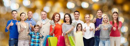 Happy people with shopping bags and money Stock Image