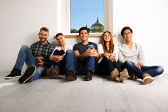 Happy people sitting on the floor Royalty Free Stock Images
