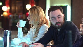 Happy people socializing and gossiping over drinks in a relaxed environment in a bar stock footage