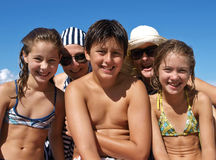 Happy people at summer. Portrait of a happy people  in bikini  - best friends  - relationship, (one boy - teenager , with four girls,- two are his sisters, and Royalty Free Stock Photo