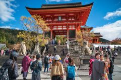 Happy People taking pictures and visiting the iconic Kiyomizu-dera buddhist temple, Kyoto, Japan. Kyoto, Japan - November 2, 2018: Happy People taking pictures royalty free stock photography