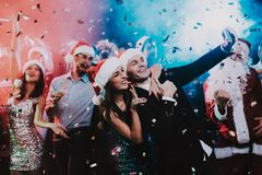 Happy People Taking Selfie on New Year Party. Happy New Year Concept. People Have Fun. Indoor Party. Celebrating of New Year. Young Woman in Dress. Young Man stock photos