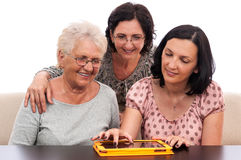 Happy people three women with tablet Stock Photography