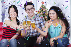 Happy people toast with champagne Royalty Free Stock Images