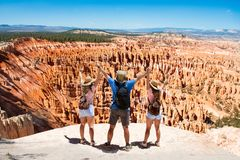 Happy people on top of beautiful mountain holding raised hands. People on hiking trip. Happy family on top of beautiful mountain holding raised hands. Bryce royalty free stock photography